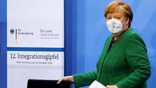 Merkel'den göçmenlere birlik çağrısı
