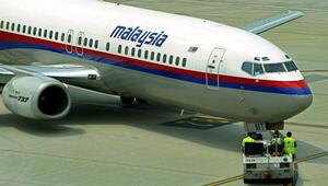 Kayıp Malezya uçağının yolcularının paralarını çalanlar yakalandı