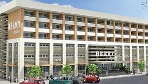 Akçaabat'taki binayı ikiye böldü, yarısı otel yarısı fabrika oldu