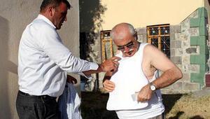 Prof.Dr. Bingür Sönmez, heykel açılışına çelik yelekle katıldı