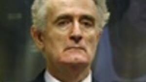Karadzic says he cannot get fair trial; blames U.S.