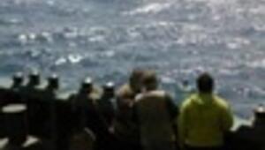 Italy starts transferring ashore migrants stranded on Turkish ship