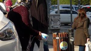 Kola dolu sonda torbasıyla dilenen kadın yine ortaya çıktı