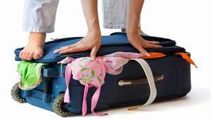 Fazla bagaj parası ödememek için ilginç yöntem
