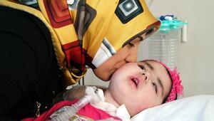 Kas hastası kızına 14 ay sonra sarılabildi