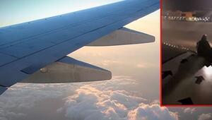 Rötara kızan yolcu uçağın kanadına oturdu
