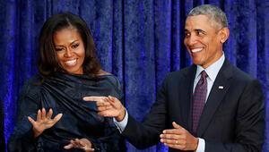 Obama çiftinden sürpriz imza
