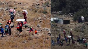 Esadin saldırılarından kaçan Suriyeliler İsrail sınırına dayandı