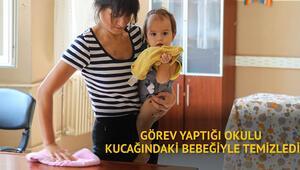 Görev yaptığı okulu kucağındaki bebeğiyle temizledi