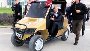 TBMM Başkanı Yıldırım, öğrencilerin yaptığı elektrikli otomobili test etti