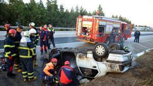 Şarampole devrilen otomobil alev aldı: 1 yaralı