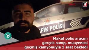 Maket polis aracını gerçek sanıp, muayenesi geçmiş kamyonuyla 1 saat bekledi