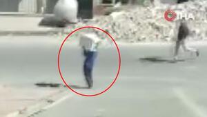 İlginç anlar Omzunda kombi ile polise yakalandı