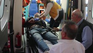 Eşini darp ederken düşerek yaralandı