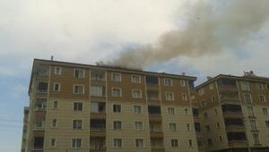 Apartmandaki çatı yangınında 9 kişi dumandan etkilendi