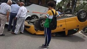 İzmirde takla atan taksi ters döndü, sürücü yaralandı