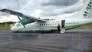 İniş takımı arızalanan uçak gövde üzerine indi