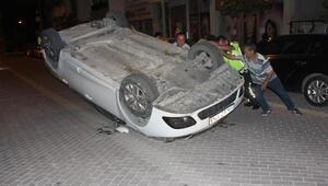 Takla atan otomobilden yara almadan kurtuldu