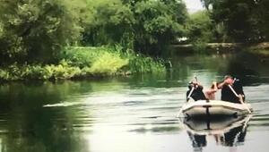 Irmağa giren Afganı dalgıçlar boğulmaktan kurtardı