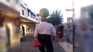 Kafasında karpuz taşıdı