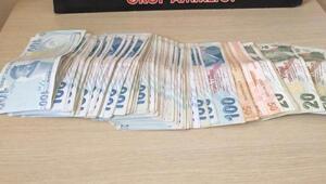 Taksicinin dikkati sahte para şüphelilerini yakalattı
