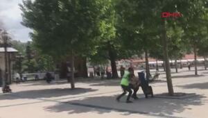 Kendini savcı olarak tanıtan dolandırıcıya polisten çöpçü kılığında operasyon
