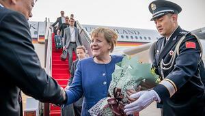 Merkel 12. kez Çin'de: Ticaret savaşları herkesi etkiliyor, çözülmeli