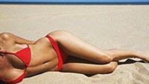 Plaja inmeden göbeğinizi indirin