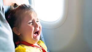 Uçakta bebeğe özel işaret
