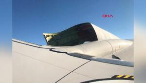 Havada uçağın motor kapağı açıldı