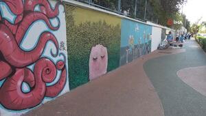 Kadın muhtar 50 ressamla caddenin duvarlarını tuvale çevirdi