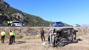Otomobil tarlaya uçtu, baba ve oğlu yaralandı