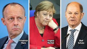 Merz'in eleştirdiği Merkel'e, Scholz sahip çıktı