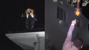 Ortalığı birbirine kattı... Çatıya çıktı, polisle çatıştı