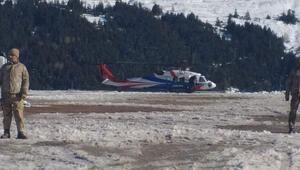 Montun bulunduğu alana helikopterle bırakılan 40 kişi, kayıp dağcıları arıyor