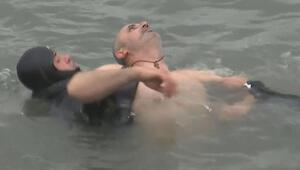 Son dakika... İstanbul'daki haç çıkarma töreninde korku dolu anlar