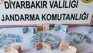 Diyarbakır'da bir kişi, üzerinde sahte 50 bin 550 lira ile yakalandı