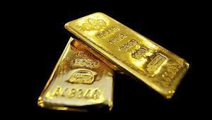 Altın yüksekte tutunuyor, petrol inişte