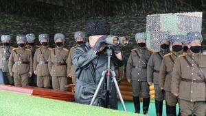 Kim Jong-undan maskesiz füze testi