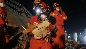 Çin'de çöken karantina otelinde 4 kişi hayatını kaybetti Kurtarılanlar arasında 2 yaşında bebek de var