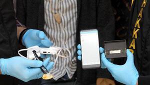 Ehliyet sınavında düğme kameralı kopya düzeneği ile yakalandı