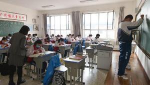 Salgının yayıldığı Çin'de eğitim tekrar başladı