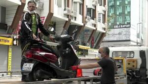 Sokağa çıkma kısıtlamasında motosiklet ile tur atarken yakalandı