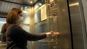 Asansörler ve apartman kapıları virüsün bulaşacağı en riskli alanlar