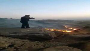 Derikte dağlık alanda çıkan yangını çevredekiler söndürdü
