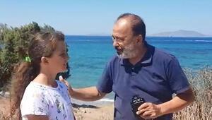 Emniyet müdürü ve kızı dalışta buldukları cep telefonunu sahibine teslim etti