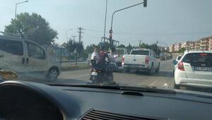 3 çocuğun elektrikli bisikletle tehlikeli yolculuğu kamerada