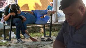 Şaşkına çeviren görüntü Parkta ölen kişiye aldırmadan bankta uyudular…