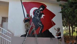 Öğretmenler ile askerler okulu boyadı