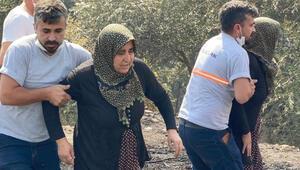 Yanan evine koşmaya çalışan kadını görevliler zor tuttu